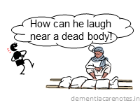 dementia patient laughs at a cremation, showing socially inappropriate behavior